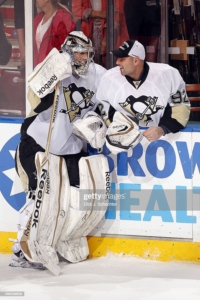 Goaltenders Marc-Andre Fleury #29 and Tomas Vokoun #92 of the Pittsburgh Penguins chat during a break in the action against the Florida Panthers at the BB&T Center on April 13, 2013 in Sunrise, Florida.