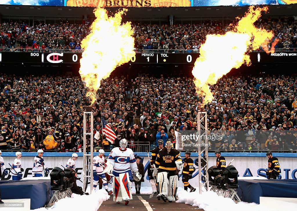 Goaltenders Mike Condon #39 of the Montreal Canadiens, Tuukka Rask #40 of the Boston Bruins and their teammates enter the field the 2016 Bridgestone NHL Classic at Gillette Stadium on January 1, 2016 in Foxboro, Massachusetts.