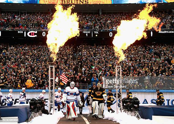 Goaltenders Mike Condon of the Montreal Canadiens Tuukka Rask of the Boston Bruins and their teammates enter the field the 2016 Bridgestone NHL...