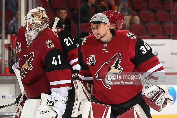 Goaltenders Mike Smith and Marek Langhamer of the Arizona Coyotes during the preseason NHL game against Anaheim Ducks at Gila River Arena on October...
