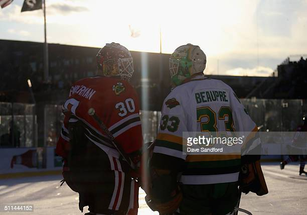 Goaltenders Murray Bannerman of the Chicago Blackhawks Alumni and Don Beaupre of the Minnesota North Stars Alumni talk on the ice during the 2016...