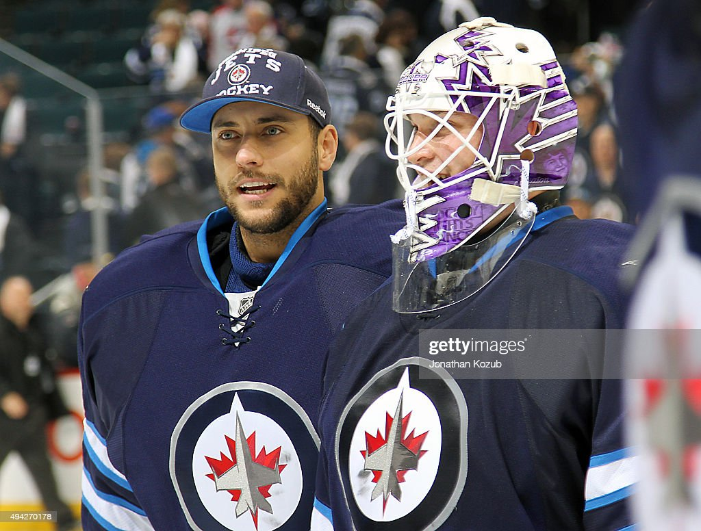 Goaltenders Ondrej Pavelec #31 and Michael Hutchinson #34 of the Winnipeg Jets are all smiles as they leave the ice following a 5-4 victory over the Minnesota Wild at the MTS Centre on October 25, 2015 in Winnipeg, Manitoba, Canada.