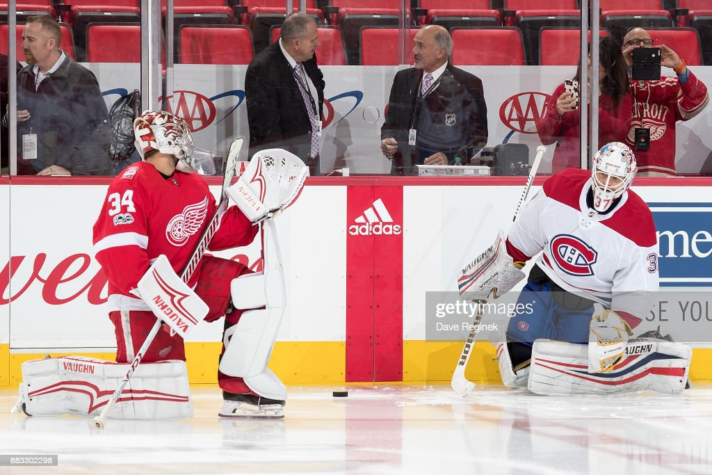Goaltenders Petr Mrazek #34 of the Detroit Red Wings and Antti Niemi #37 of the Montreal Canadiens warm-up along the boards prior to an NHL game at Little Caesars Arena on November 30, 2017 in Detroit, Michigan.