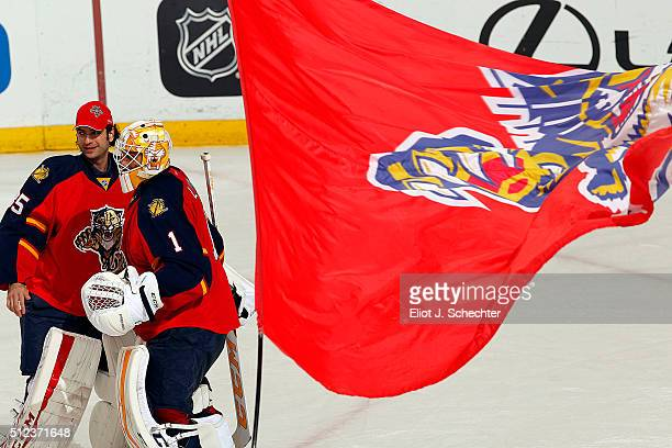 Goaltenders Roberto Luongo and Al Montoya of the Florida Panthers celebrate their win against the Arizona Coyotes at the BBT Center on February 25...