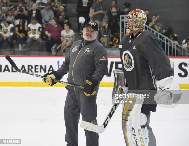 Goaltending coach David Prior of the Vegas Golden Knights talks with goalie Maxime Lagace during the team's first practice since winning the Western...