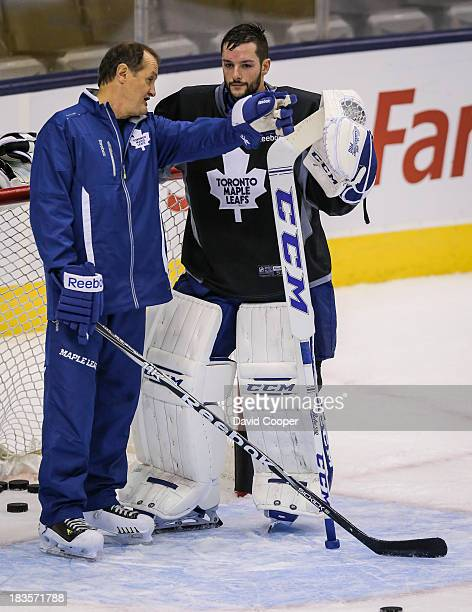 TORONTO ON OCTOBER 7 Goaltending coach Piero Greco talks with Toronto Maple Leafs goalie Jonathan Bernier during practice at the Air Canada Centre in...