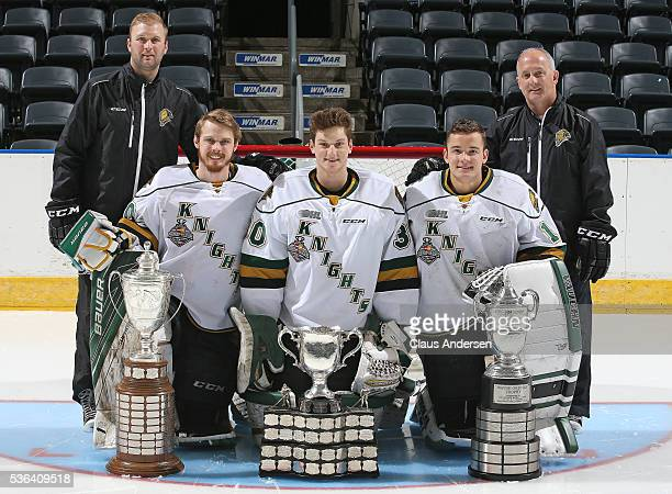 Goaltending coaches Daren Machesney and Dave Rook pose for a photo with Brendan Burke Emanuel Vella and Tyler Parsons of the London Knights and the...