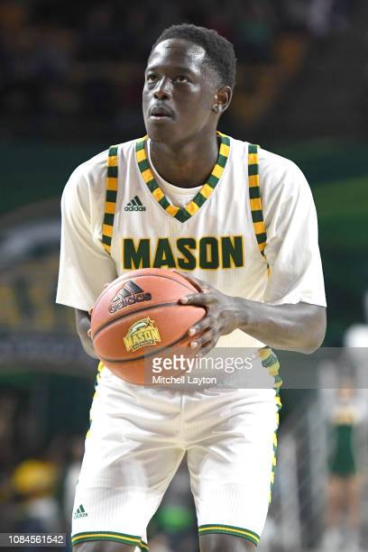 Goanar Mar of the George Mason Patriots takes a foul shot during a college basketball game against the Southern University Jaguars at the Eagle Bank...