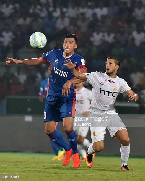 FC Goas defender Lucimar Da Silva Ferreira vies for the ball with Northeast United FC's forward Emiliano Alfaro during the Indian Super League...