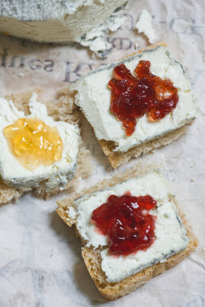 Goat cheese and conserves on fresh bread