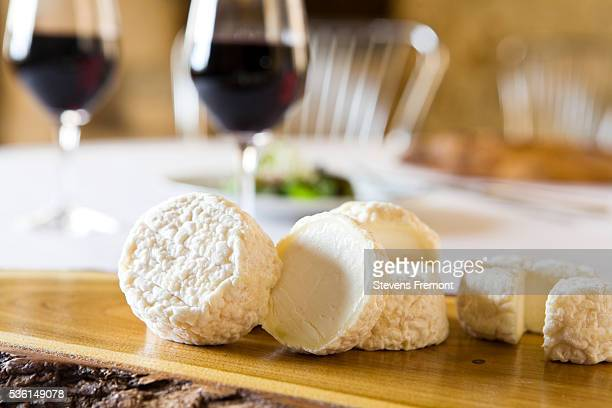 Goat cheese and glass of red wine in the restaurant La Maison Tourangelle in the village of Savonnières, the Loire Valley, France