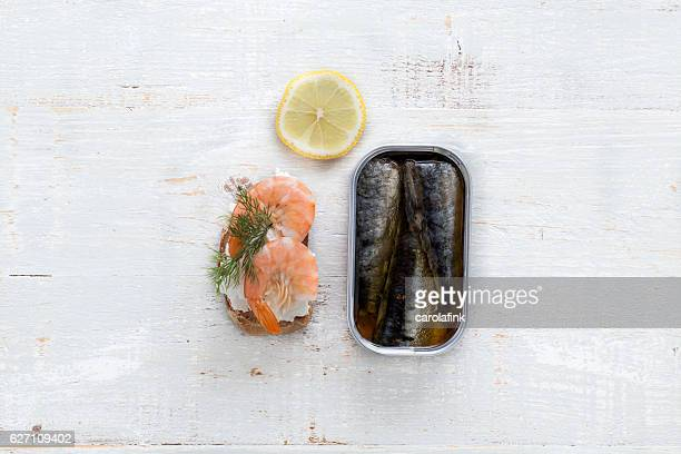 goat cheese canapé with sardines - carolafink stock photos and pictures