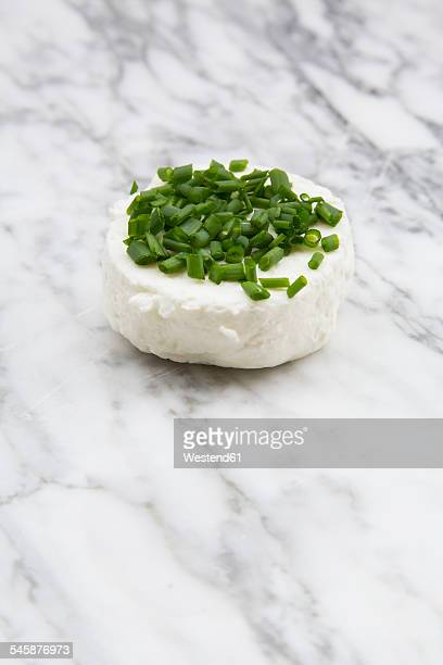 Goat cheese with chives on marble