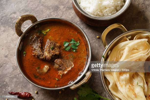goat or lamb curry with rice and roti - pakistan stock-fotos und bilder
