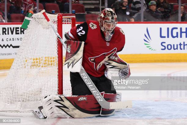 Goatlender Antti Raanta of the Arizona Coyotes makes a save on a shot from the Edmonton Oilers during the second period of the NHL game at Gila River...