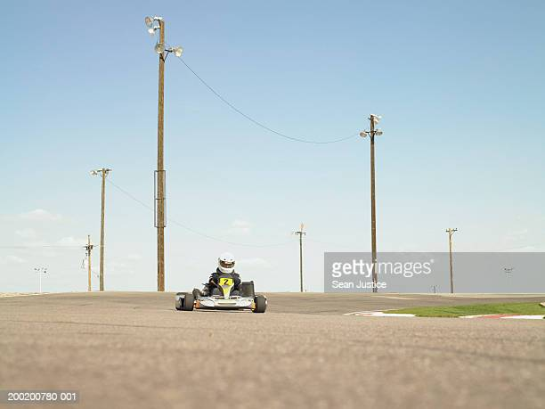 Go-cart racer turning corner on track