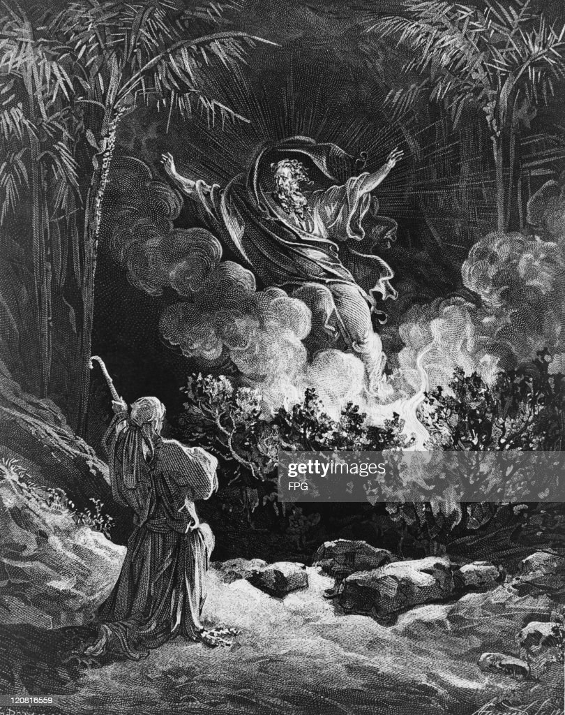 God appears to Moses in the burning bush, instructing him to lead the Israelites out of Egypt into Canaan. The Bible records the incident in the Book of Exodus (3:1-21). Wood engraving, circa 1850, drawn by Gustave Doré (1832 - 1883) and cut by Adolphe Gusman (1821 - 1905).