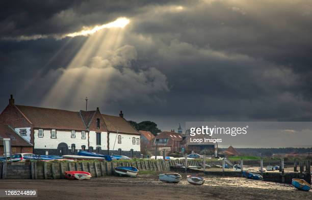 God beams or crepuscular rays at Burnham Overy Staithe.