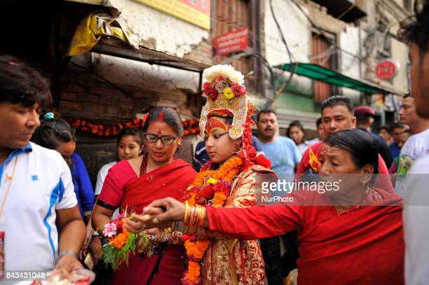 God 'Bhairab' walks towards chariot for the chariot pulling festival on the fourth day of Indra Jatra Festival celebrated at Basantapur Durbar Square...