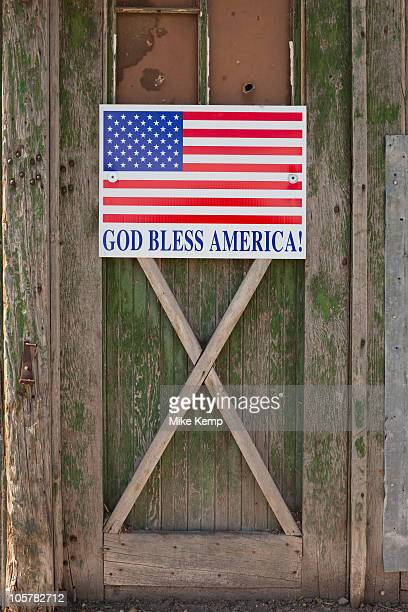 God bless American sign on barn door