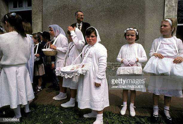 God Festival In France In 1987 Girls in their Sunday best participant in the procession of Corpus ChristiThe baskets are filled with rose petals that...