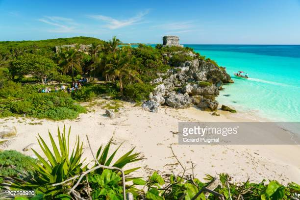 god of winds (dios del viento) temple in a sunny day. ruins of tulum, a pre-columbian mayan walled city in yucatán peninsula on the caribbean sea in the state of quintana roo, mexico. - mexican god stock pictures, royalty-free photos & images