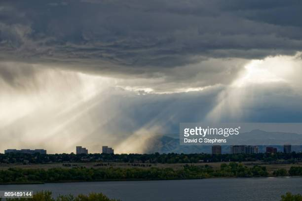god rays fall on denver tech center - front range mountain range stock pictures, royalty-free photos & images