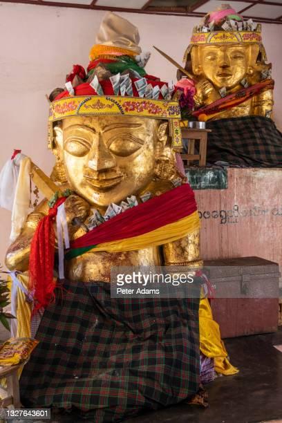 god statue at shwezigon paya, bagan, myanmar - peter adams stock pictures, royalty-free photos & images