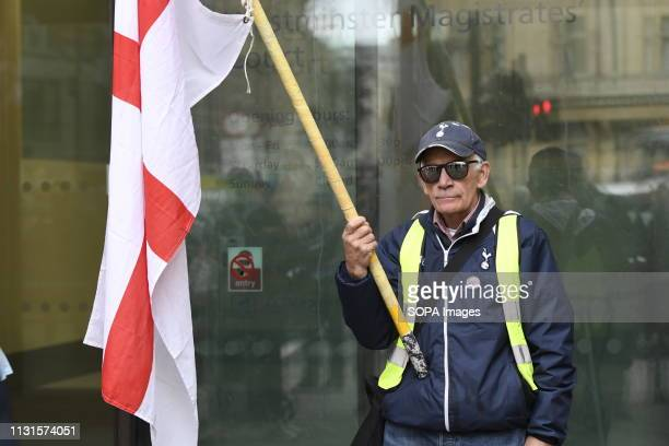 Godard's supporter holding a St Georges's Cross flag outside Westminster Magistrates Court Brexit protester and leading member of the Yellow Vest UK...