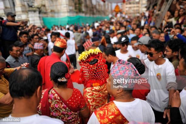 Goddess 'Kumari' living goddess of Kathmandu walks towards chariot for the chariot pulling festival on the fourth day of Indra Jatra Festival...