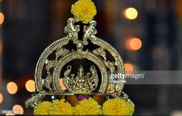 goddess lakshmi brass lamp/gajalakshmi vilakku with marigold flowers against beautiful  bokeh-diwali - goddess lakshmi stock photos and pictures