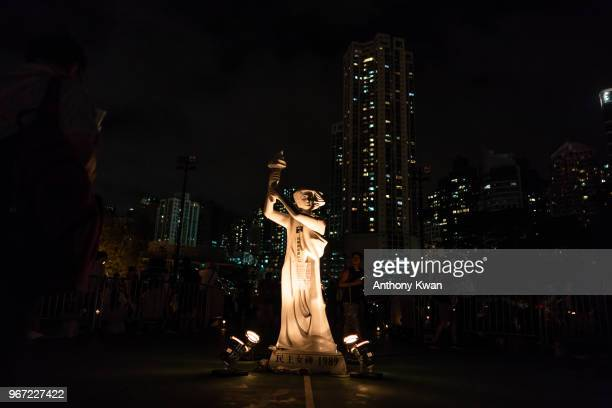 Goddess of Democracy statue stands during the candlelight vigil at Victoria Park on June 4 2018 in Hong Kong Hong Kong Thousands of people in Hong...