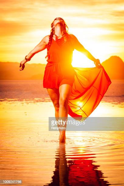goddess walking in water at sunset - mystic goddess stock photos and pictures