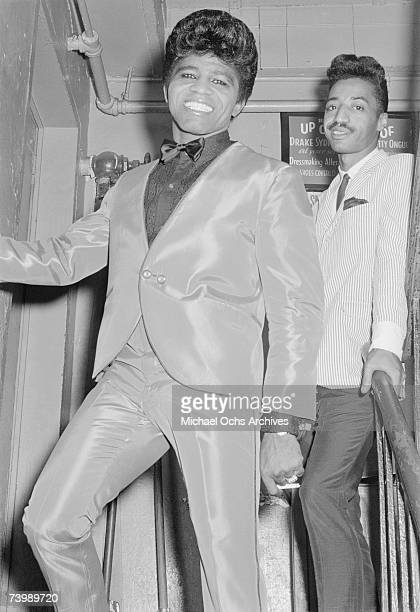 'Godfather of Soul' James Brown backstage at the Apollo Theatre with his cape man Danny Ray in 1964 in New York New York