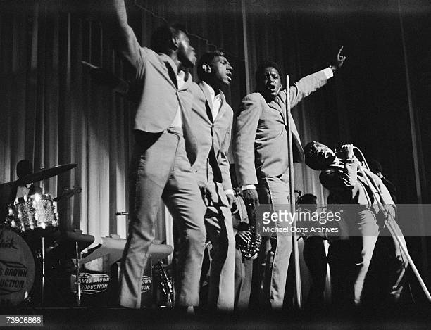 Godfather of Soul James Brown performs with the Famous Flames at the Apollo Theatre in 1964 in New York New York