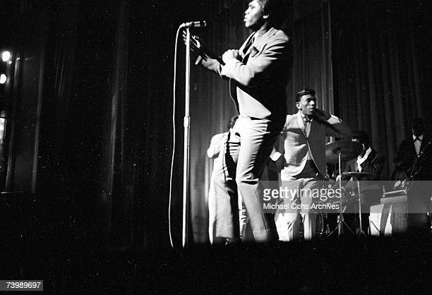 Godfather of Soul James Brown performs with The Famous Flames at the Apollo Theater in 1964 in New York New York