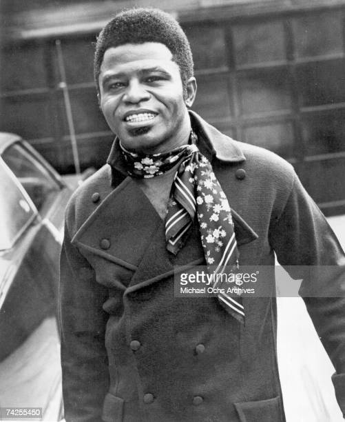 'Godfather of Soul' James Brown poses for a portrait wearing a scarf in circa 1965