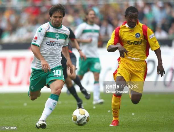 Godfried Aduobe of Karlsruhe tackles Diego of Bremen during the Bundesliga match between SV Werder Bremen and Karlsruher SC at Weserstadion on May 16...