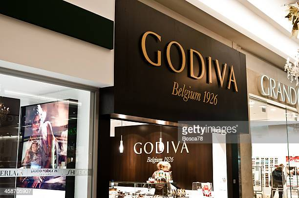 godiva chocolate brand name over a shop entrance - lady godiva stock pictures, royalty-free photos & images