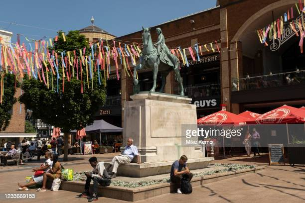 Godiva statue underneath colourful bunting hanging in Broadgate in the UK City of Culture 2021 on 23rd June 2021 in Coventry, United Kingdom. The...