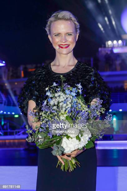 Godmother Iveta Apkalna wearing a top by Sportmax, a skirt by Max Mara and jewellry by Pomellato during the naming ceremony of the cruise ship 'Mein...