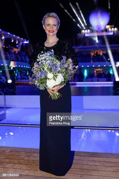 Godmother Iveta Apkalna wearing an outfit by Max Mara and jewellry by Pomellato during the naming ceremony of the cruise ship 'Mein Schiff 6' on June...