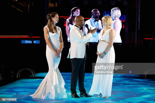 Godmother Kira Walkenhorst wearing a dress by Lever Couture, Yared Dibaba and godmother Laura Ludwig during the naming ceremony of the cruise ship...