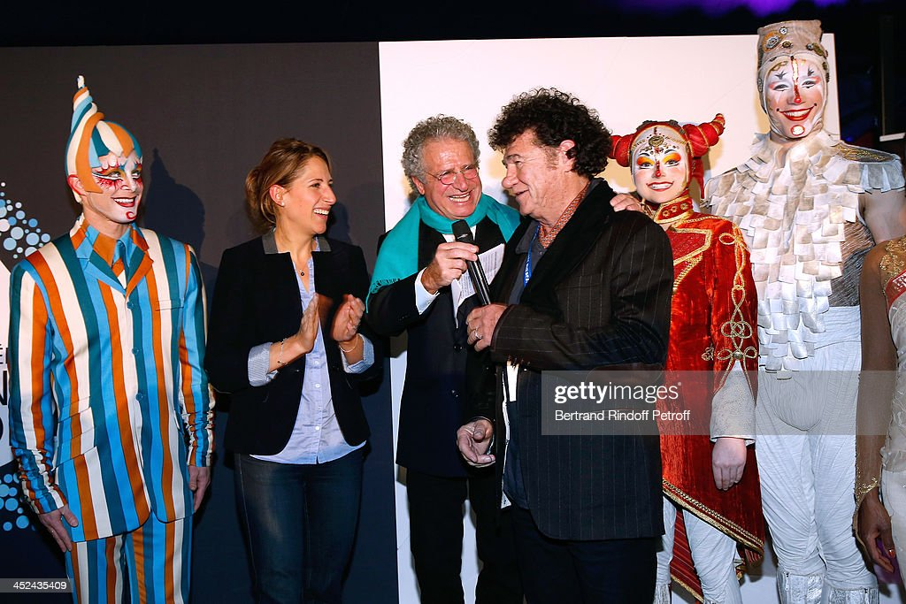 Godmother of One Drop France Maud Fontenoy, CEO One Drop France Laurent Dassault, singer Robert Charlebois and actors of the Cirque attend the 'One Drop' Gala, held at Cirque du Soleil on November 28, 2013 in Paris, France.