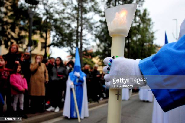 L´HOSPITALET CATALONIA SPAIN A godmother of the 15 1 brotherhood seen carrying a candle or a rosary with the cross of Jesus Christ during the parade...
