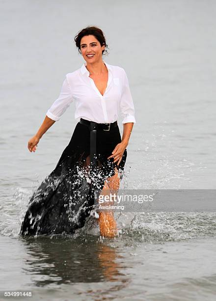 Godmother of the festival Luisa Ranieri pose during the photocall at Excelsior beach in Venice, Italy