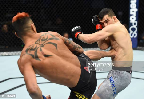 Godofredo Pepey of Brazil kicks Mirsad Bektic of Bosnia in their featherweight bout during a UFC Fight Night event at Spectrum Center on January 27...
