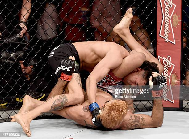 Godofredo Pepey of Brazil submits Andre Fili of the United States in their featherweight bout during the UFC Fight Night at Maracanazinho Gymnasium...