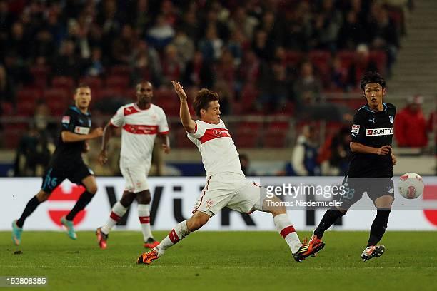 Godoku Sakai of Stuttgart fights for the ball with Takashi Usami of Hoffenheim during the Bundesliga match betwen VfB Stuttgart and TSG 1899...