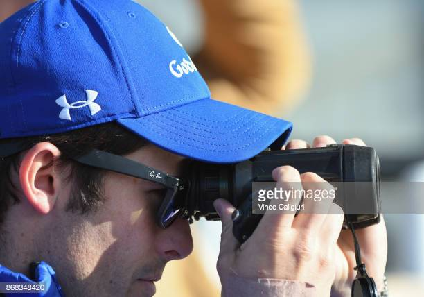 Godolphin trainer James Cummings looks through his binoculars as he clocks his horses during a trackwork session at Flemington Racecourse on October...